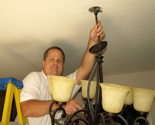 Lighting Simi Valley Electrical Contractor Installing Chandelier